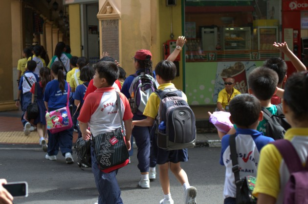 Kids walking to school in Singapore