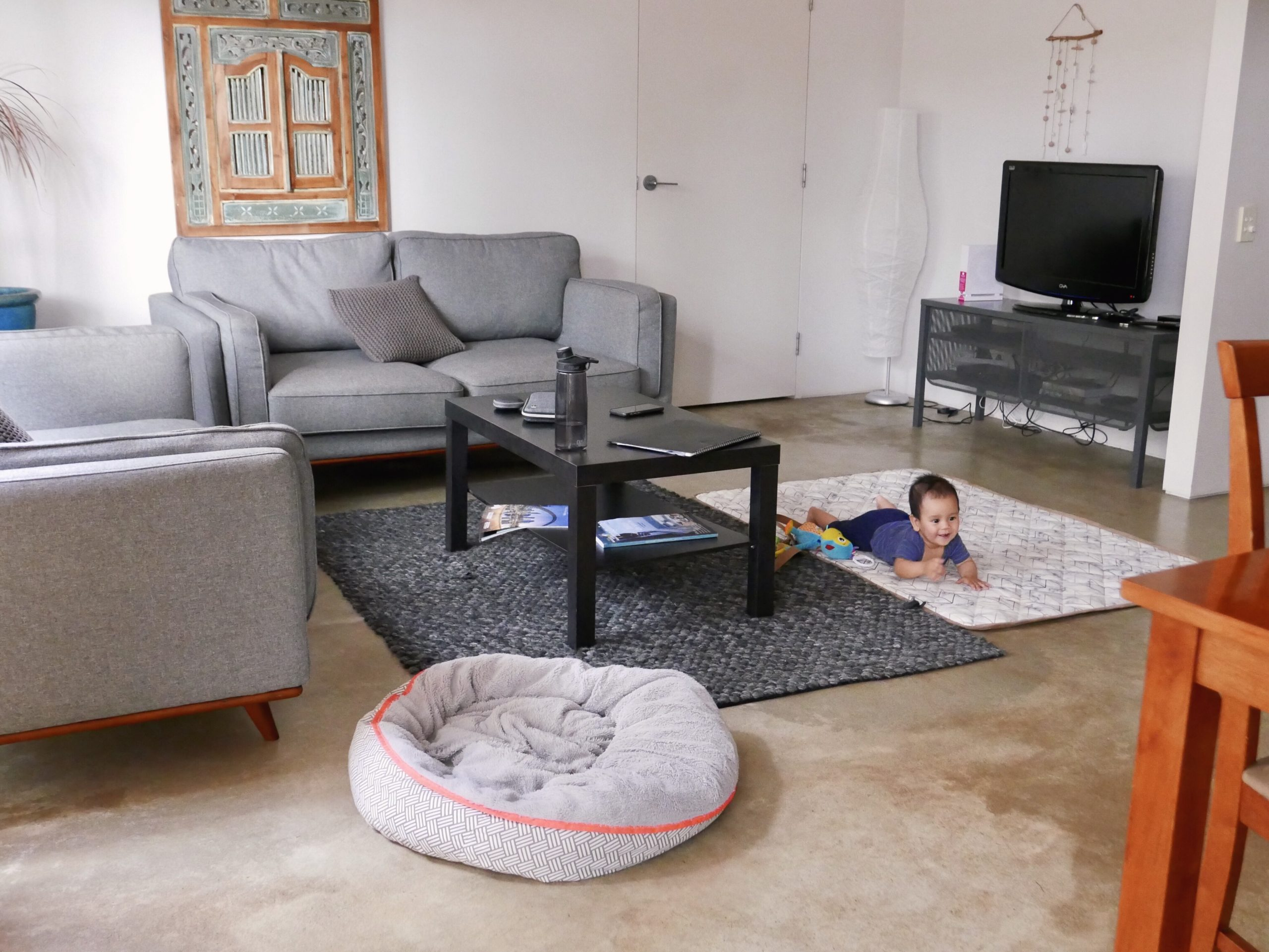 Photo of a baby crawling on the floor of a living room
