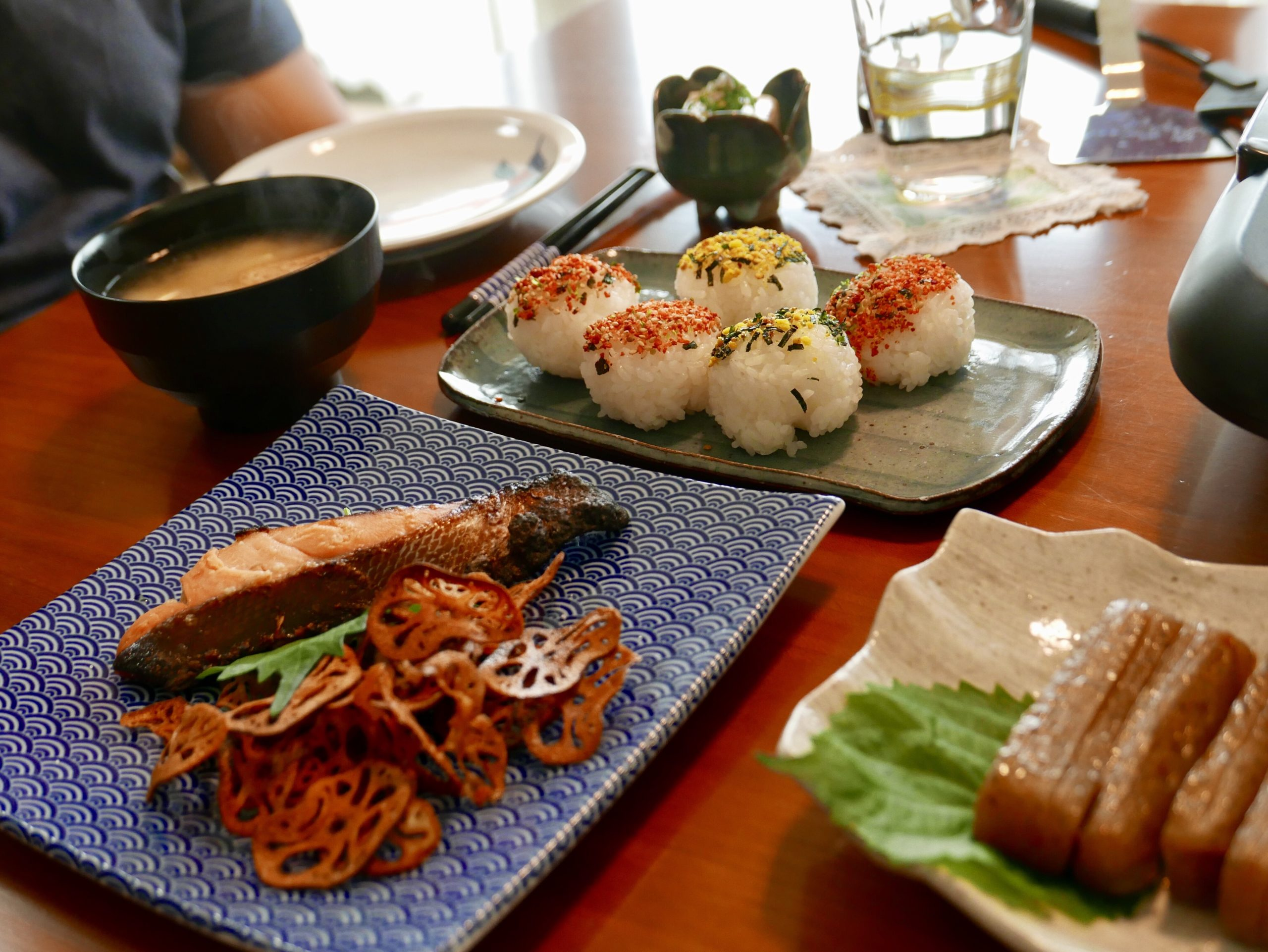 Rice balls, fried lotus, grilled salmon and konyakku