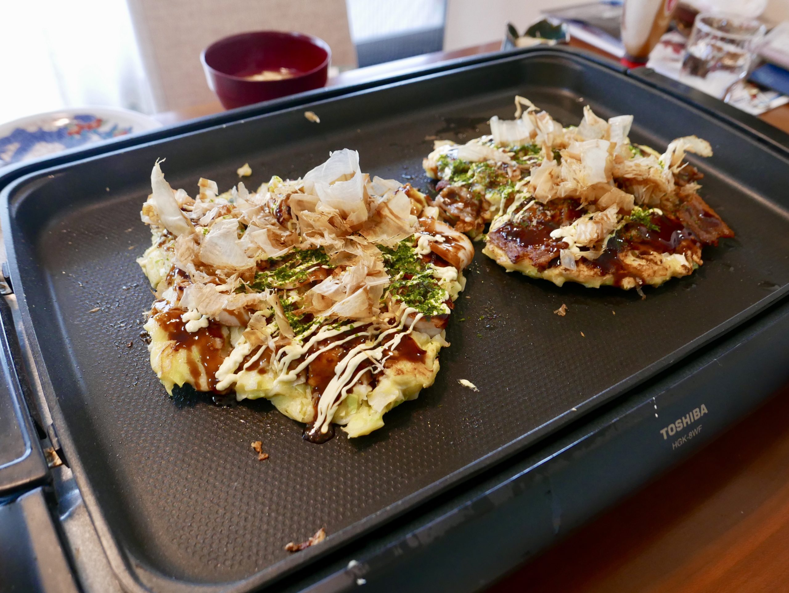 2 okonomiyaki on hot grill