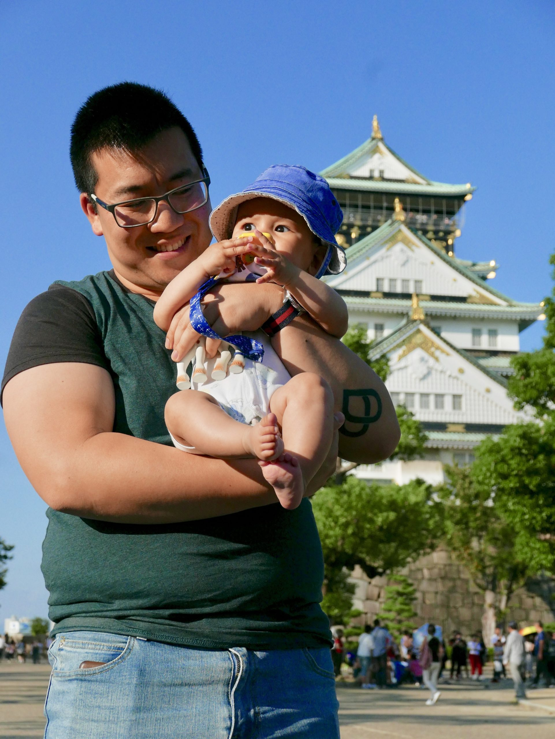 Dad holding baby in front of Osaka Castle