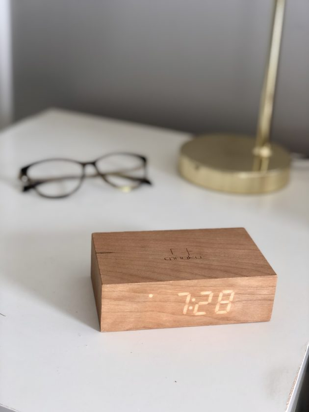 Wooden block showing a digital clock