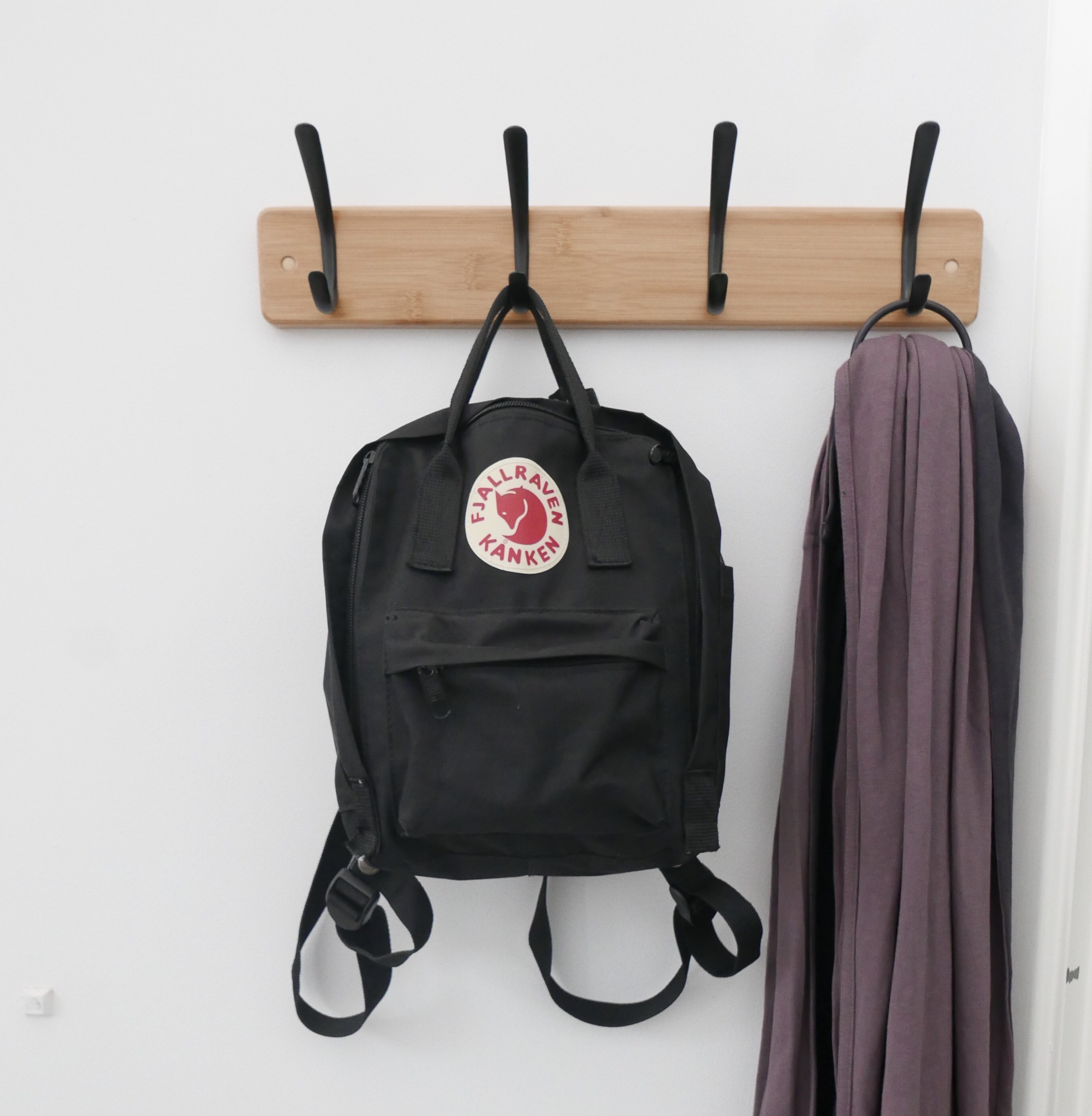 Backpack and ring sling hanging up by my door