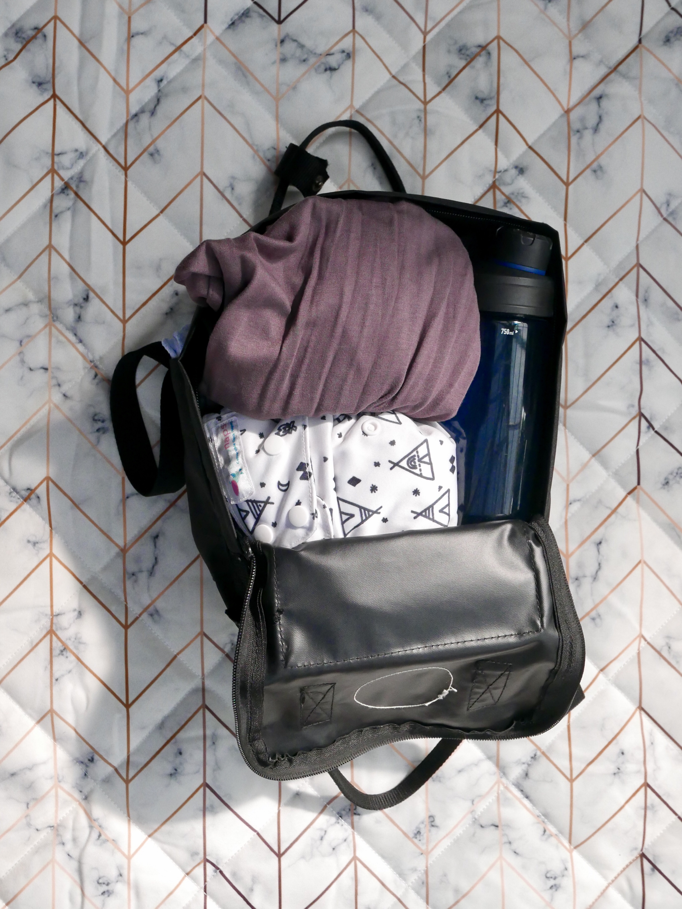 Backpack at full capacity with essentials plus a ring sling