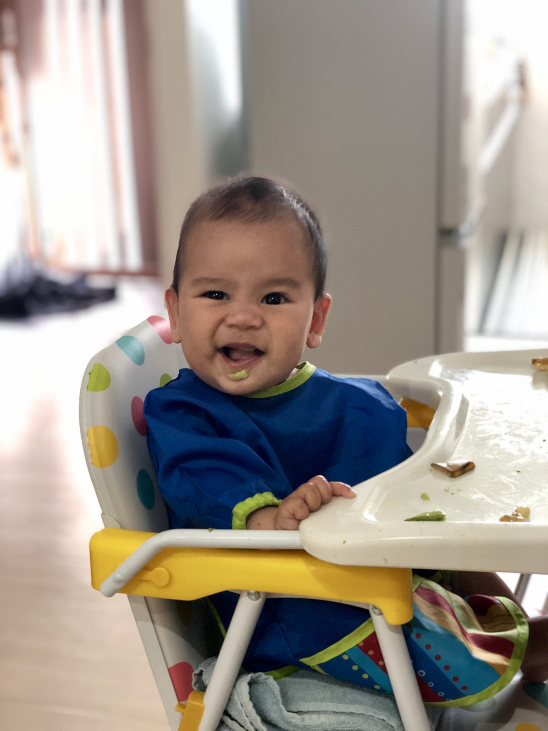 Baby sitting in a high chair