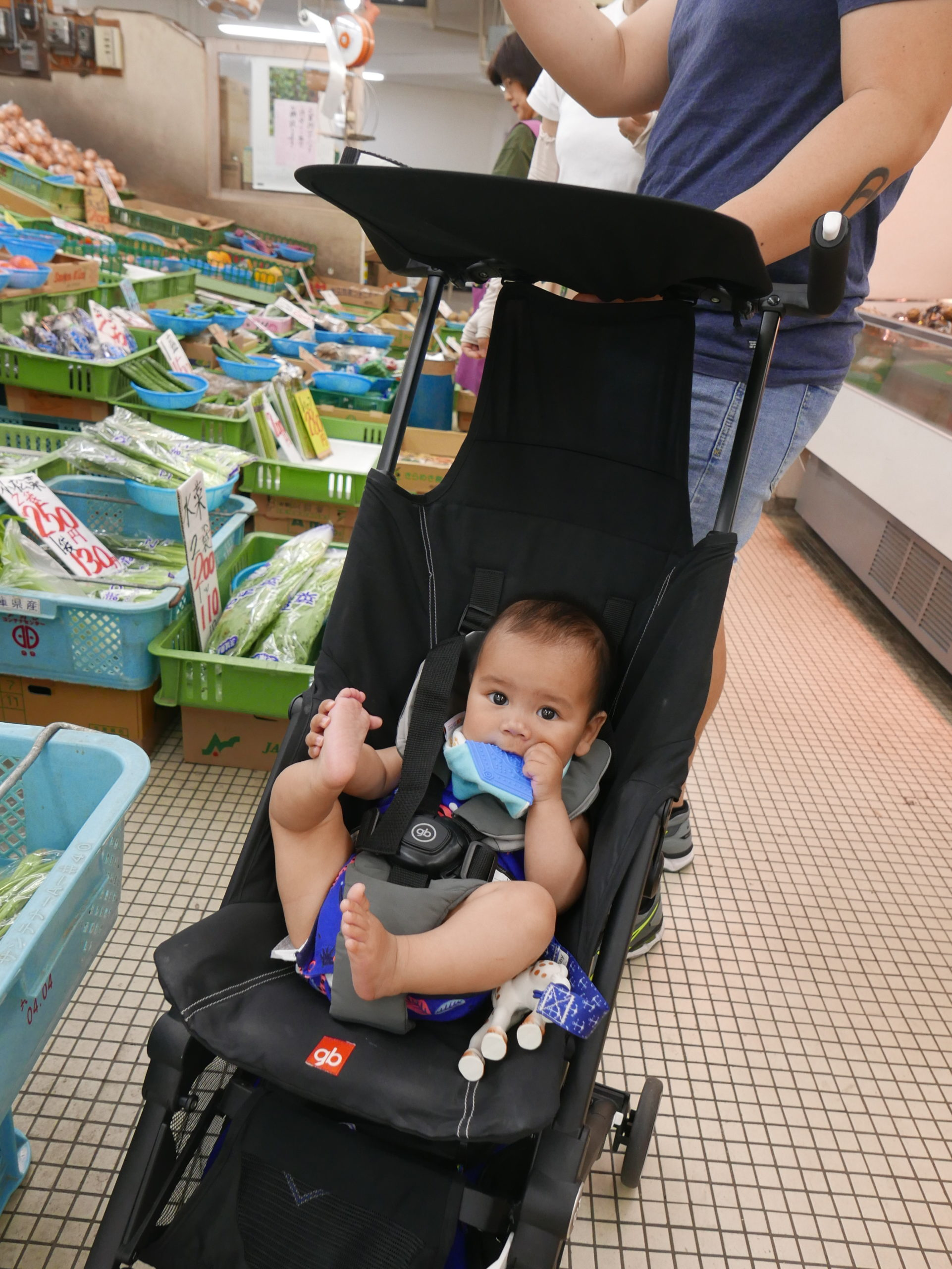 Baby sitting in a travel pram
