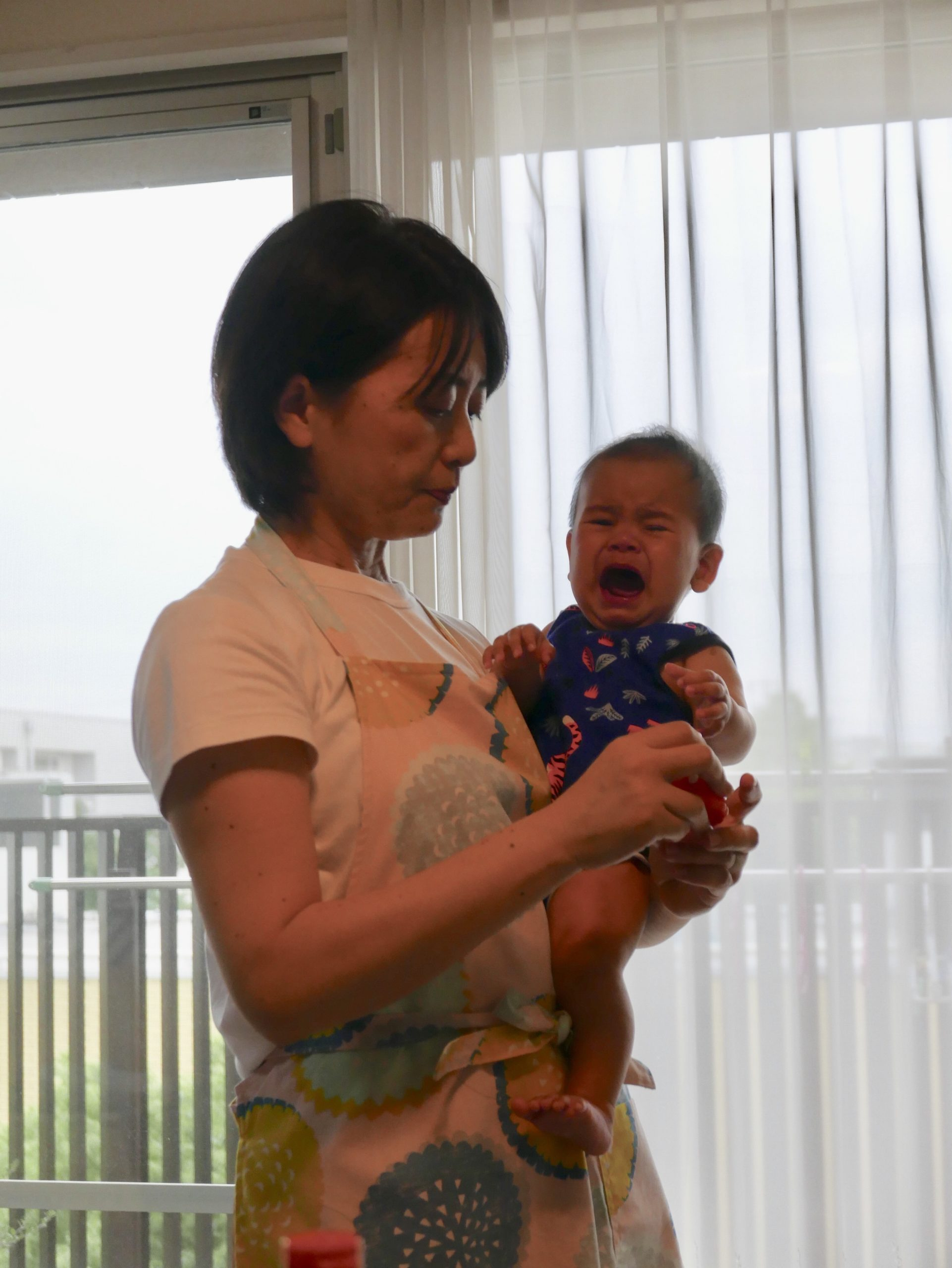 Japanese woman holding crying baby